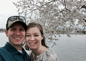 Photograph of the author and her husband at the Jefferson Memorial with a view of the DC cherry blossoms